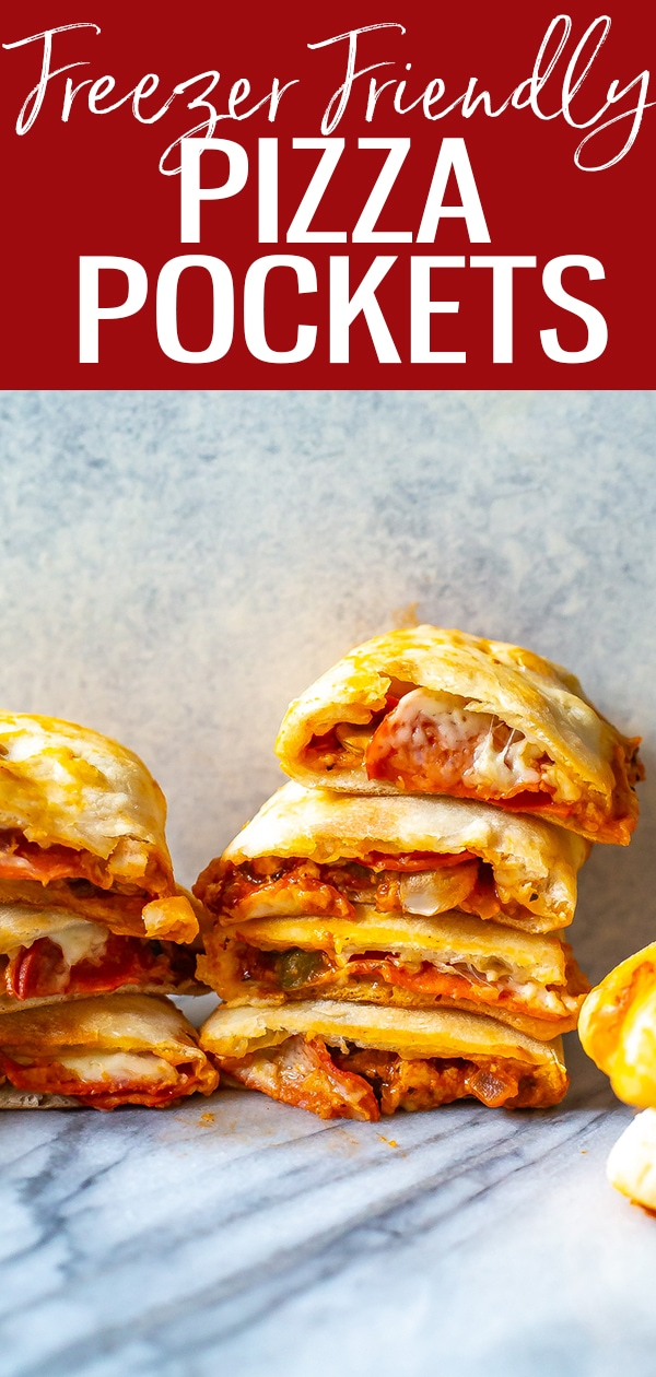 These Homemade Pizza Pockets are SO easy to make using store bought pizza dough and your favorite toppings - plus you can freeze them to enjoy anytime! #pizzapockets #freezermeal