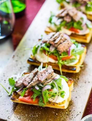 These Open Faced Steak Caprese Sandwiches are a deliciously simple lunch idea layered with buffalo mozzarella, arugula, balsamic vinegar and thinly sliced red onion on fresh focaccia bread!