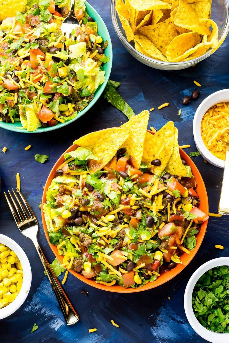 This Doritos Taco Salad is a delicious 20-minute dinner filled with fresh veggies and Cool Ranch Doritos, then topped with cheese, cilantro and taco sauce!