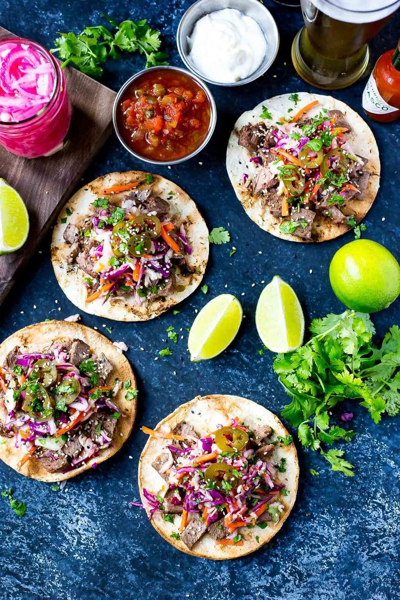These Kalbi Beef Tacos are seasoned with sesame oil for an Asian-inspired flair, then topped with a delicious citrus slaw, pickled red onion and jalapenos!