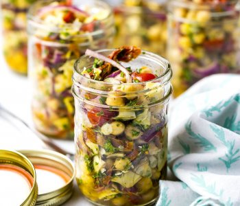 These Mediterranean Chickpea Salad Jars with artichokes and sundried tomatoes are the perfect packable lunch - they're also high protein, vegetarian and gluten-free!