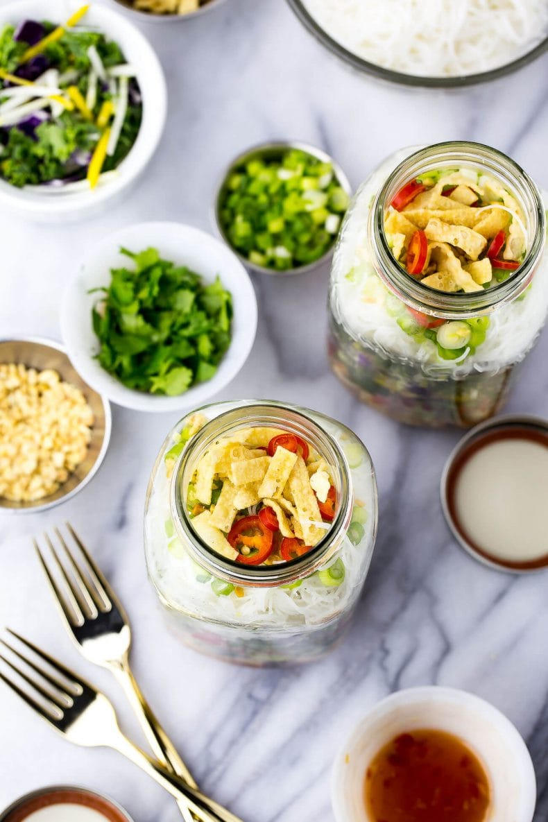 This Sweet Chili Chicken Salad Jars are the perfect grab and go lunch, filled with a delicious kale and red cabbage slaw along with vermicelli noodles and wonton crisps!