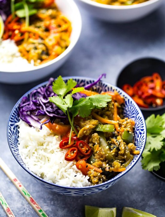 These Thai Basil Chicken Bowls with Coconut Rice, bell peppers, carrots and red cabbage are the most delicious stir fry bowls and are ready in just 20 minutes. They also make great leftovers!