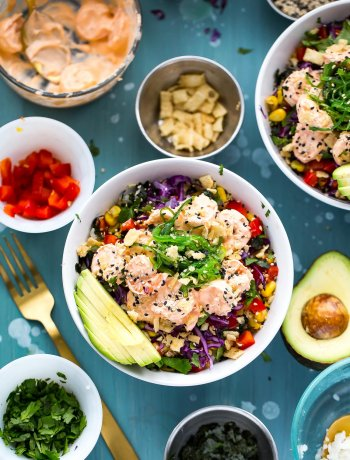 These Creamy Sriracha Shrimp Poke Bowls are a delicious twist on a traditional tuna poke with seaweed salad, lemongrass corn, avocado and wonton strips!