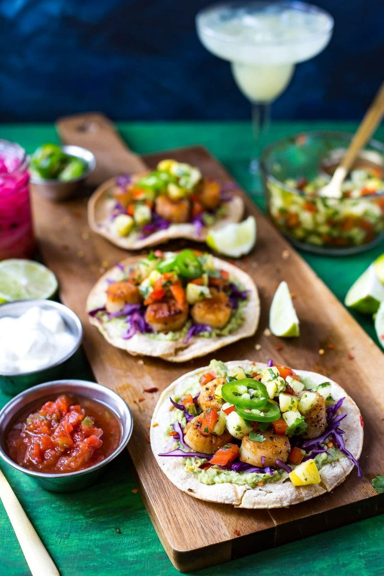 These spicy Seared Scallop Tacos with a savoury cilantro-filled Pineapple Salsa and served on corn tortillas are the perfect party food for Cinco de Mayo - with a twist!