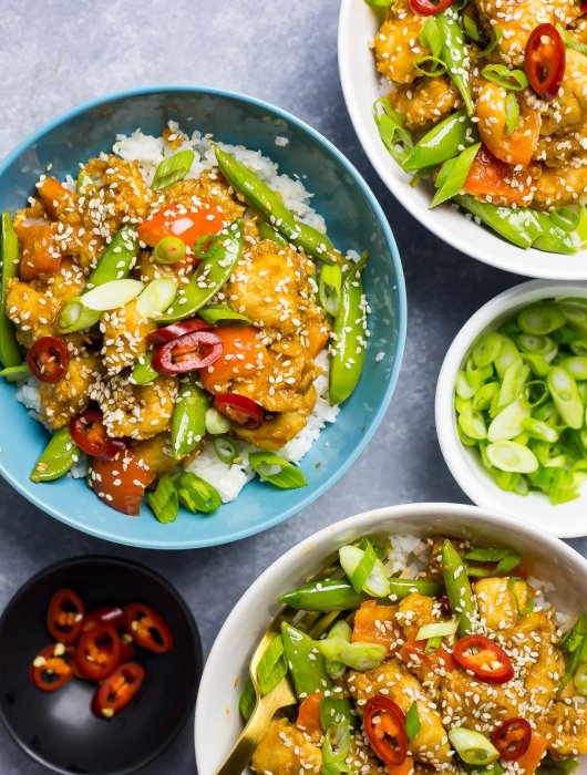 These 20-Minute Sesame Chicken Rice Bowls with jasmine rice and snap peas are a healthy takeout substitute, and ready in under half an hour!