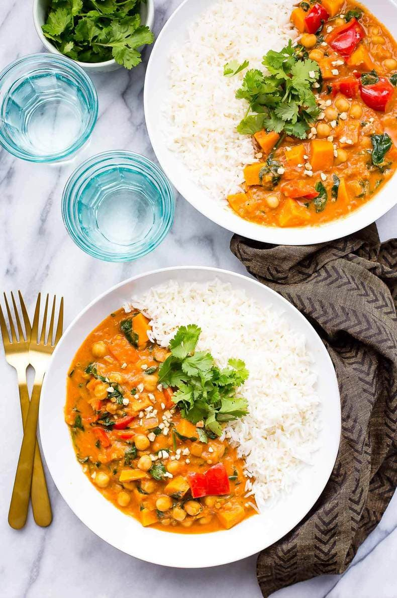 This Slow Cooker African-Inspired Peanut Stew is a hearty, savoury chickpea and sweet potato curry, served with basmati rice and topped with cilantro. It's also gluten-free and vegan!