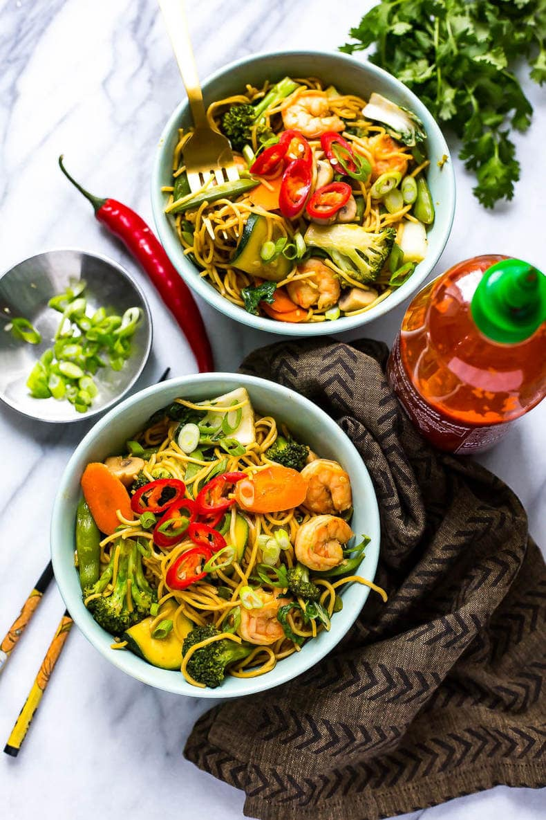 These Shrimp Yakisoba Noodle Bowls are a filling, healthy 30-minute dinner filled with stir fry noodles and veggies in a savoury, garlic-chili sauce! Say goodbye to takeout with these!