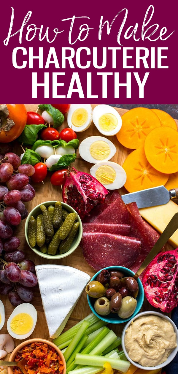 This Protein-Packed Healthy Charcuterie Board is a delicious holiday appetizer idea with low-calorie ingredients like hard-boiled eggs, lean-deli turkey, a variety of cheeses, pickles, hummus and more! #charcuterie #meatandcheese