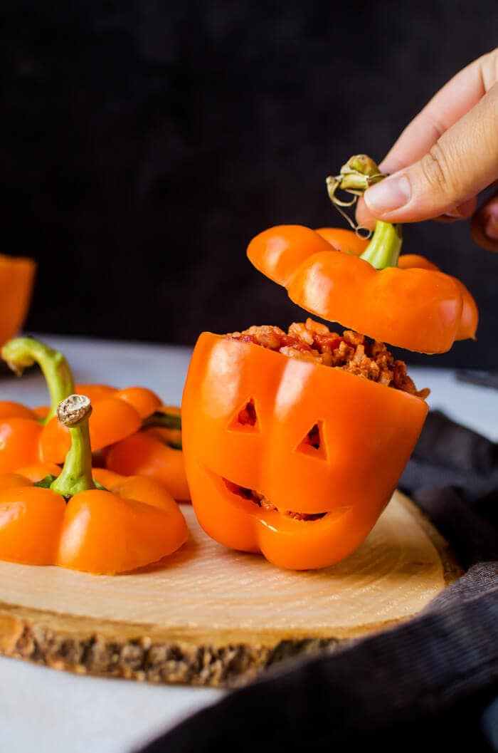orange stuffed bell peppers carved to look like Jack O Lanterns