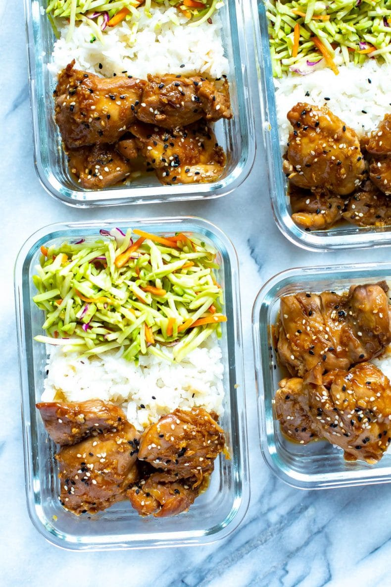 glass meal prep container with Asian sesame chicken dinner