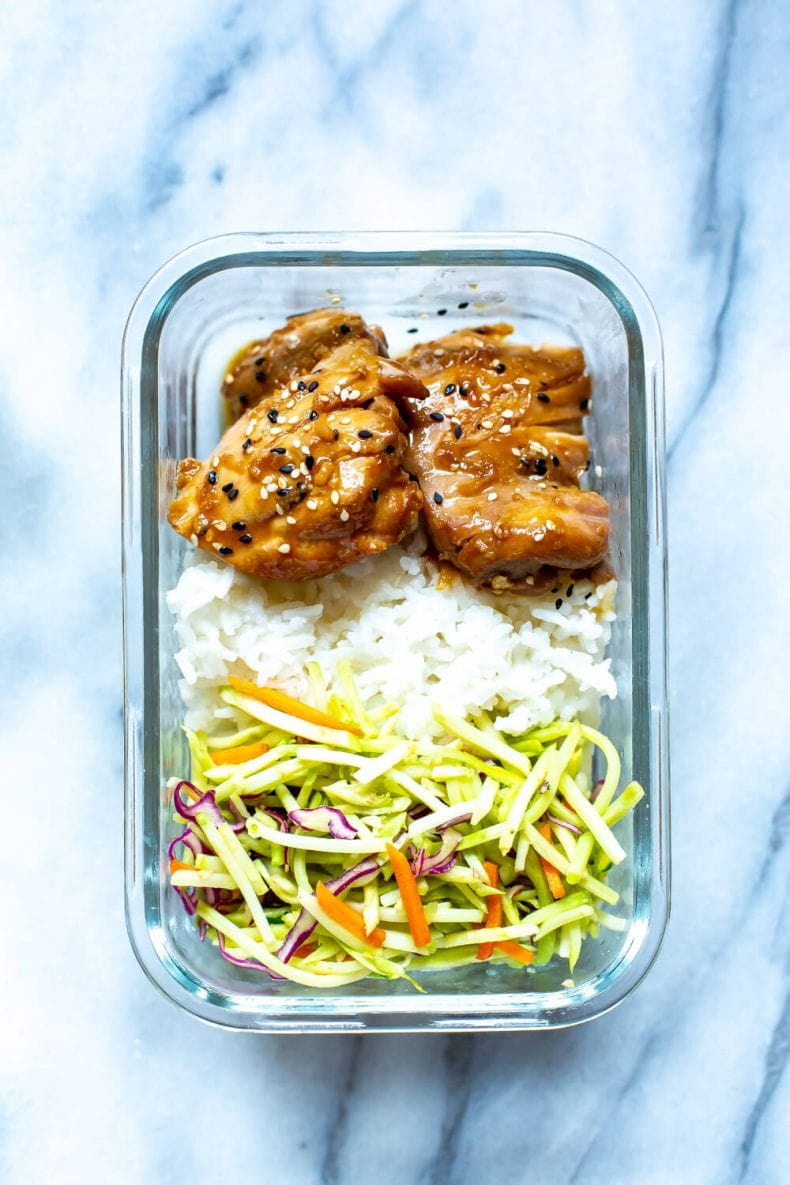 meal prep dinner of Garlic Sesame Chicken Thighs, white rice, and broccoli slaw
