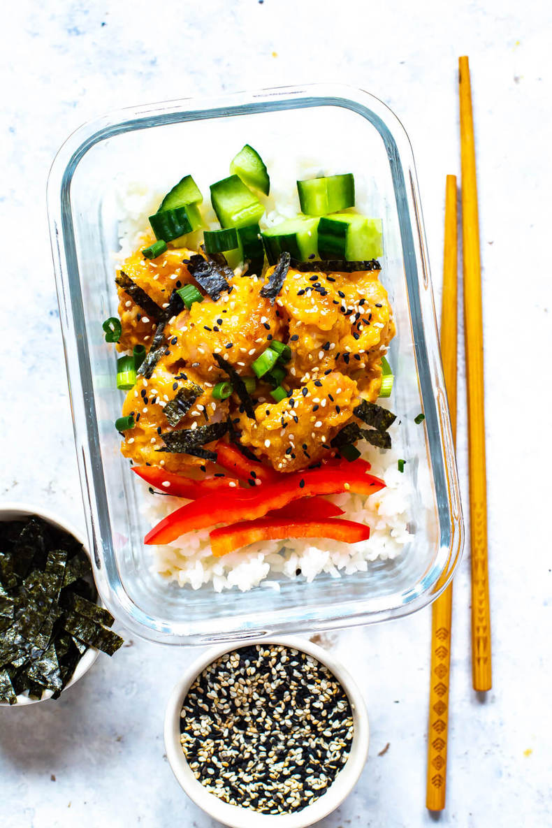 Shrimp sushi bowl next to chopsticks