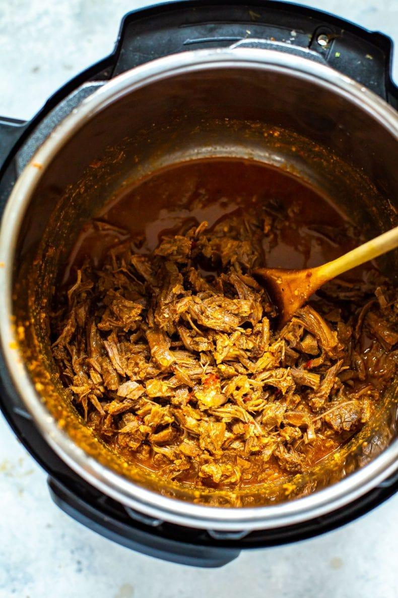 shredded Barbacoa beef in a pressure cooker