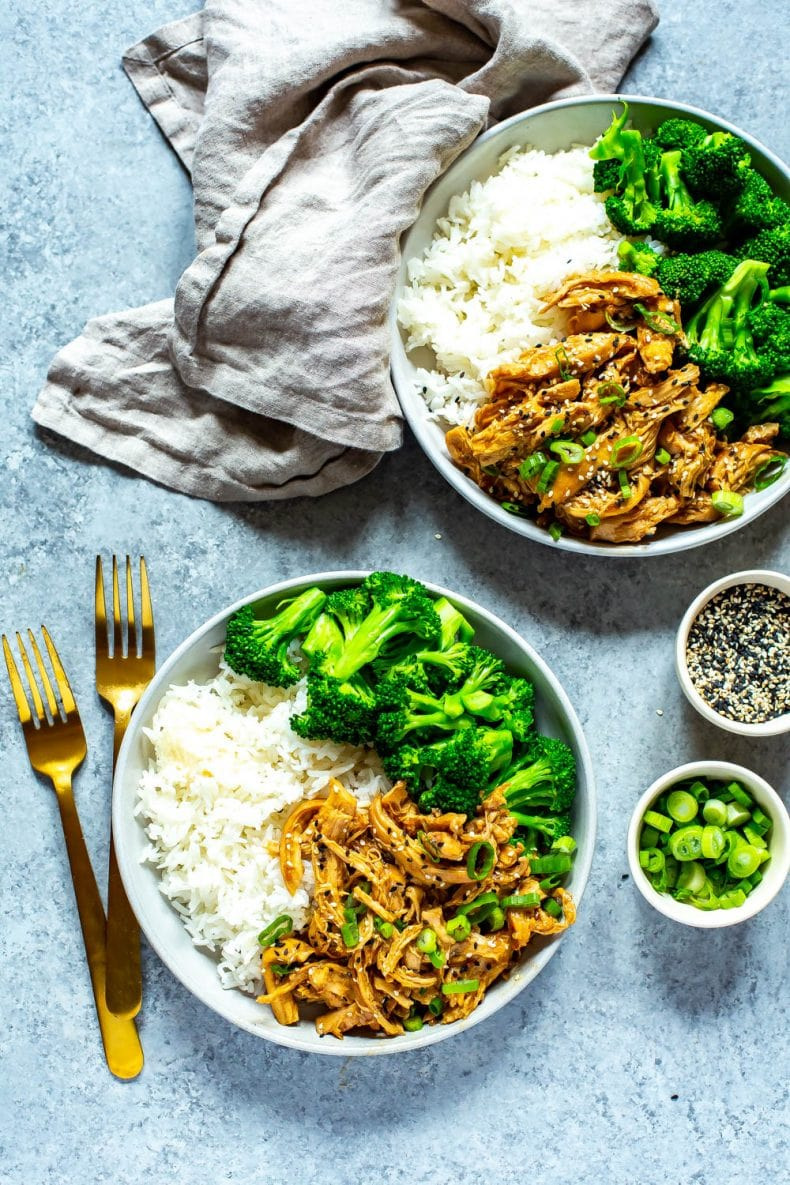 5-Ingredient Crock Pot Chicken Teriyaki on white plates with rice and broccoli