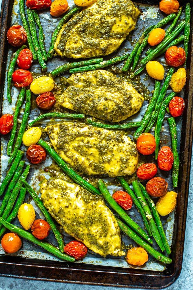 2-Ingredient Baked Pesto Chicken and roasted vegetables sheet pan dinner