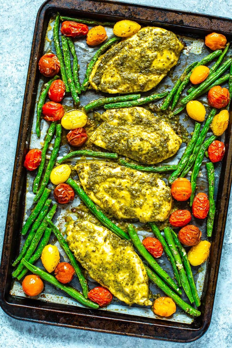 sheet pan chicken dinner made with jarred pesto sauce
