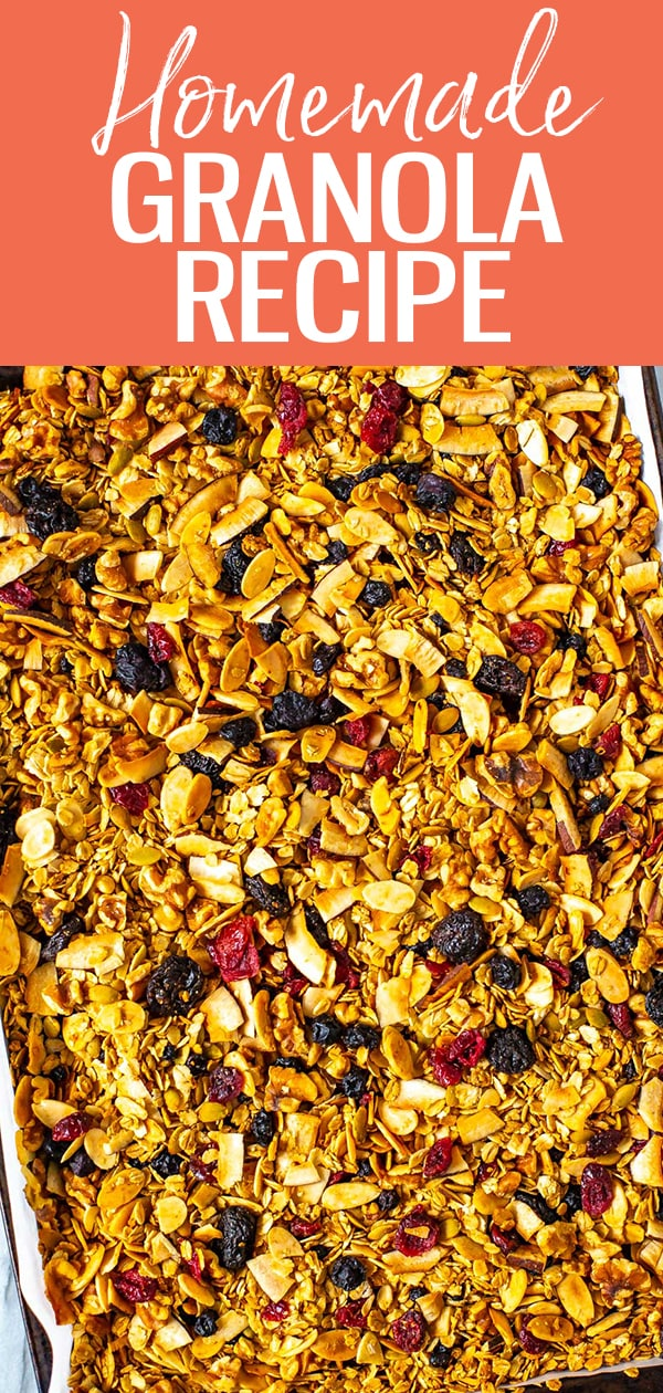 This healthy Homemade Granola Recipe is the BEST & easy to make with no refined sugars! Just add rolled oats, nuts, coconut, dried berries & maple syrup! #homemadegranola
