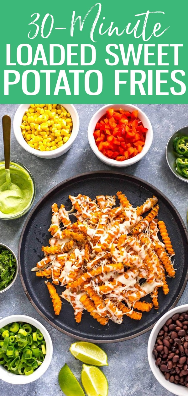 These Easy Loaded Tex Mex Sweet Potato Fries with avocado cilantro sauce are a delicious vegetarian dinner idea that comes together in 30 minutes. Prep the toppings while the fries are cooking! #sweetpotatofries #loadedfries