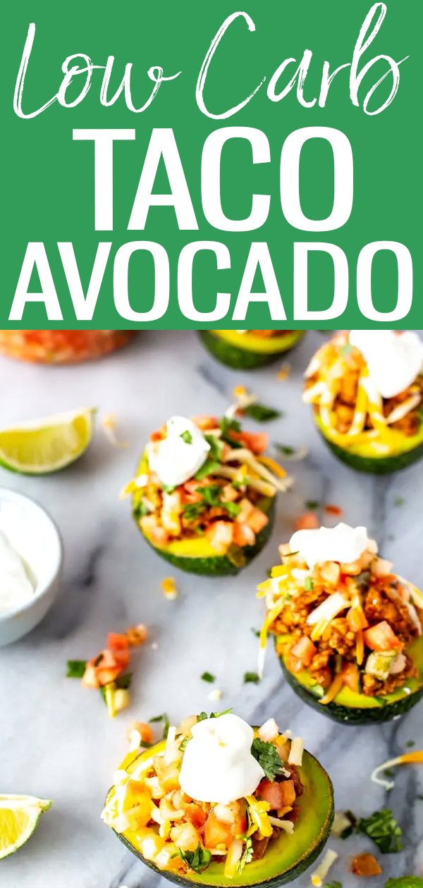 These Low Carb Taco Stuffed Avocados are filled with seasoned ground turkey and topped with pico de gallo, cheese and sour cream. #tacoavocado #lowcarb