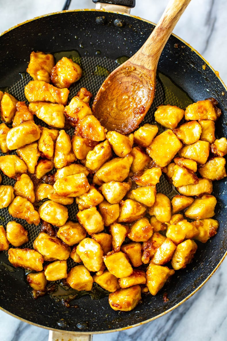 stir frying chicken pieces in a skillet